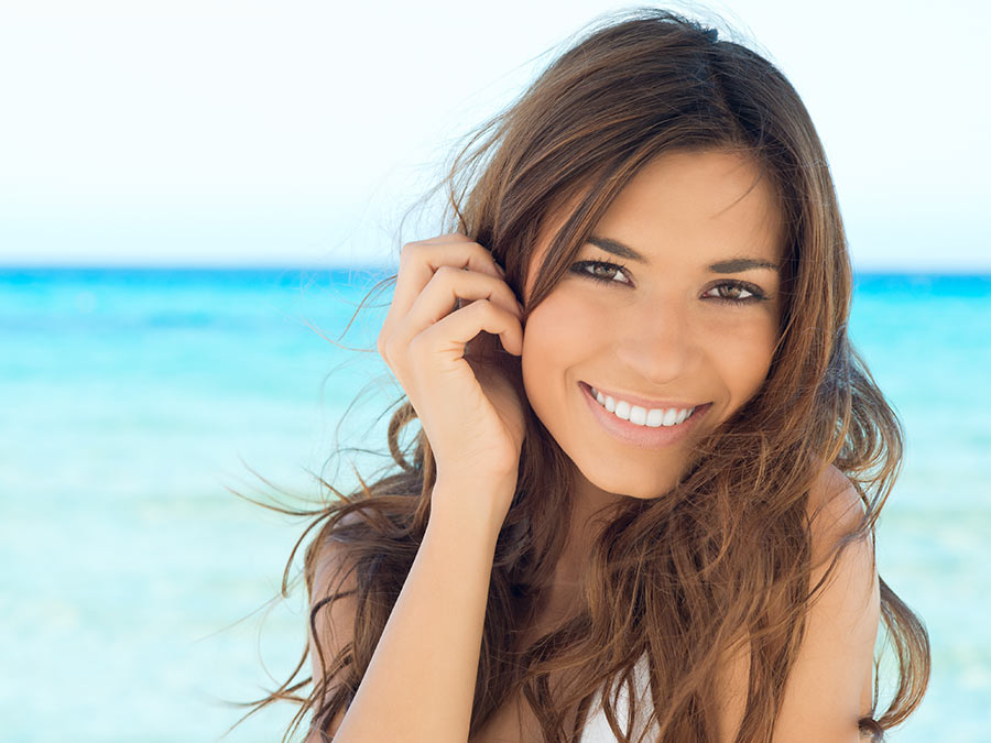 Teeth-Whitening Treatment or Dental Implant Procedure