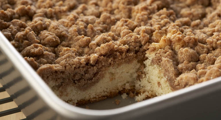 ... cinnamon-spiced crumb topping sits atop coffee cake that starts with a