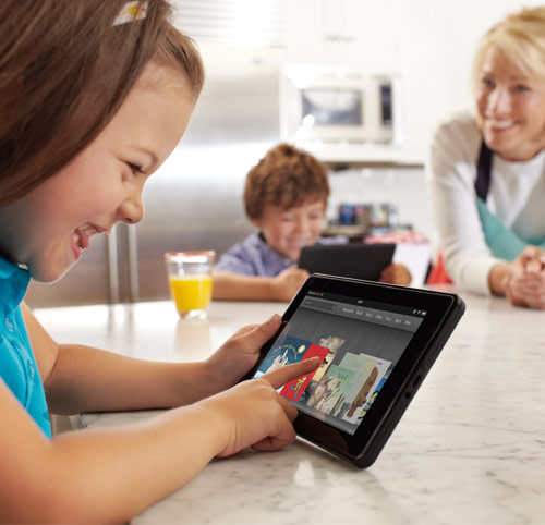 Kindle Fire: young girl using Kindle Fire in the kitchen
