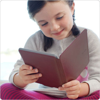 Kindle Touch e-reader: girl reading Kindle with pink Kindle cover.