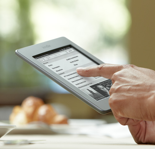 Kindle Touch e-reader: device held in one hand, with finger on touchscreen