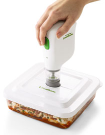 FoodSaver FreshSaver Rechargeable Handheld Vacuum System sealing a FoodSaver container