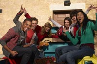 group of friends sitting in the back of a pickup truck