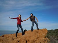 couple hiking a cliff