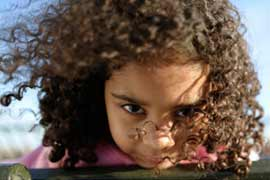 photo of girl with brown curly hair