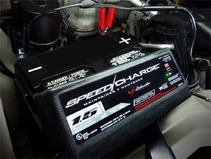 The Schumacher SEM-1562A 1.5 Amp Speed Charge Maintainer in use under the hood
