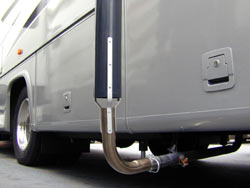 The Camco Gen-turi RV Generator Exhaust Venting System attaching to a RV generator exhaust pipe