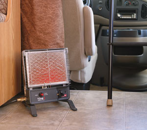 The Camco Olympian RV Wave-3 3000 BTU LP Gas Catalytic Heater with optional leg stand accessories attached