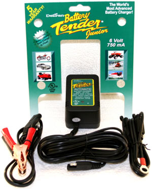 The Deltran Battery Tender Junior 6V Battery Charger with alligator clips, ring terminal, output cord and packaging