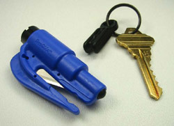 A royal blue ResQMe detached from key chain revealing its blade