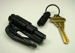 A black ResQMe detached from key chain revealing its blade