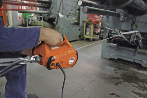 Warn Works 685000 PullzAll 110V AC Corded Electric Pull Tool used to pull an item in a shop setting