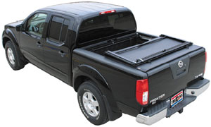 A TruXedo Deuce soft roll-up tonneau cover installed on a Dodge Ram truck