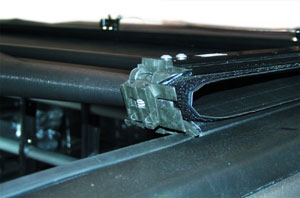 Close-up of the front-end hinged side rail and Velcro combination of the TruXedo Deuce soft roll-up tonneau cover