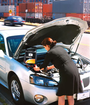 Woman using the Duracell DJUMP-17 Instant Jumpstart System to jumpstart her car