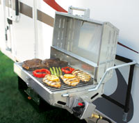 The Camco 57305 Olympian RV 5500 Stainless Steel RV Grill grilling a meal while attached to the side of an RV