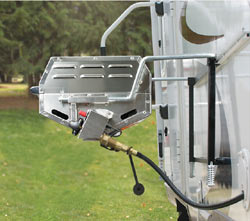 The Camco 57305 Olympian RV 5500 Stainless Steel RV Grill showing a propane hookup