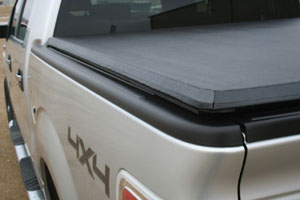 The smooth look of the TruXedo TruXport soft roll-up tonneau cover seen from the driver's side rear