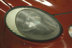A clouded headlight lens prior to repair using the 3M 39014 Lens Renewal Kit