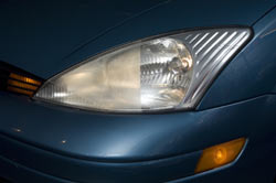 A before and after comparison of a headlight restored using the Sylvania Headlight Restoration Kit