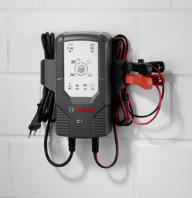 The Bosch C7 12V and 24V, Fully Automatic 6-Mode Battery Charger and Maintainer mounted on a wall