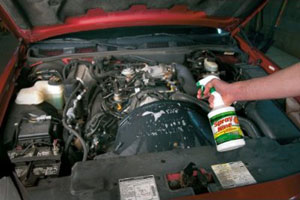 Spray Nine cleaner and disinfectant used to degrease a car engine