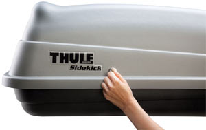 One of two side locks included with the Thule 682 Sidekick Rooftop Cargo Box