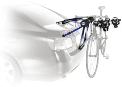 The Thule Speedway 3-Bike Trunk Rack Carrier mounted on a car rack