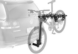 Thule Ridgeline 4-Bike Hitch Carrier w/Retractable Locking Cable mounted on a small car