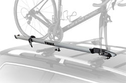 The Thule Echelon Fork Mount Rooftop Bicycle Carrier mounted on a car rack
