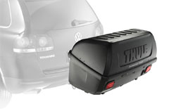 A Thule 665C Transporter Combi Hitch-Mount Cargo Box mounted on a car