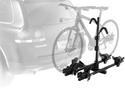 The Thule 990XT Doubletrack Platform Hitch Bike Rack mounted on a small car
