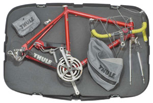 A view of the Thule 699 Round Trip Bicycle Travel Case open, with a bike packed inside