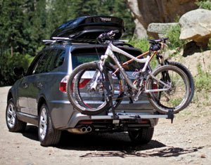 The Thule 611 Boxter Rooftop Cargo Box combined with a bike rack on a car