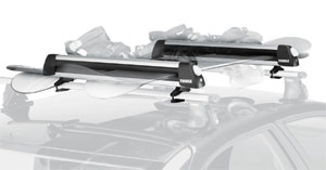 The Thule 91724 Universal Flat Top Ski and Snowboard Carrier mounted on a rack
