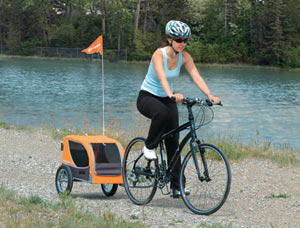 The Croozer Mini Dog being towed by a cyclist