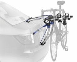 The Thule 9006 Gateway 2-Bike Trunk/Strap Mount Rack mounted on a car trunk