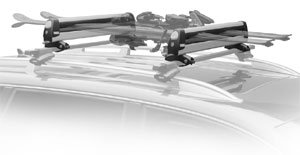 An installed Thule 92724 universal flat top 4 pair ski and snowboard carrier loaded with skis