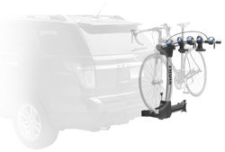 An installed Thule 9027 Apex swing away 4-bike hitch mount carrier in the locked position