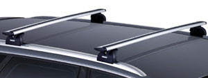 Thule AeroBlade roof rack bars installed on vehicle's rack feet
