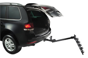 An unloaded Parkway 4-Bike Hitch Mount Carrier Rack in the down position allowing access to a hackback