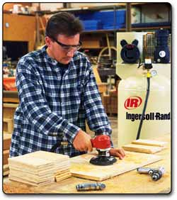Ingersoll Rand 311A Heavy-Duty Six-Inch Dual-Action Quiet Air Sander in use.