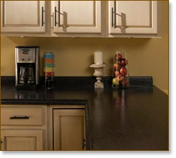 Rust Oleum Stone Effects Countertop http://www.amazon.com/Rust-Oleum-Countertop-Transformations-Java-Stone/dp/B004LB5EWI