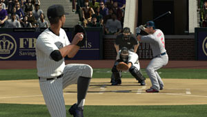 Pitcher delivering the ball from the stretch to a waiting hitter in Major League Baseball 2K11