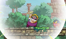 Wario bringing on an earthquake with his fist  in 'Wario Land: Shake It!'
