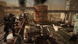 Small scale squad-based combat in an industrial setting in MAG