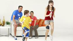 Two kids using the Nunchuck leg strap to do cardio exercises in ''EA SPORTS Active''