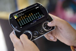 Black PSP Go, with controls visible, playing a music track