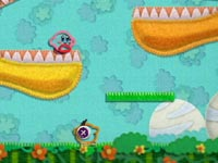 Kirby platforming through dinosaur jaws in Kirby's Epic Yarn