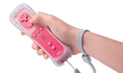 Pink Wii Remote Plus controller in-hand with strap and skin